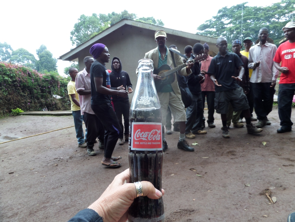 Warm coke after a long climb kilimanjaro
